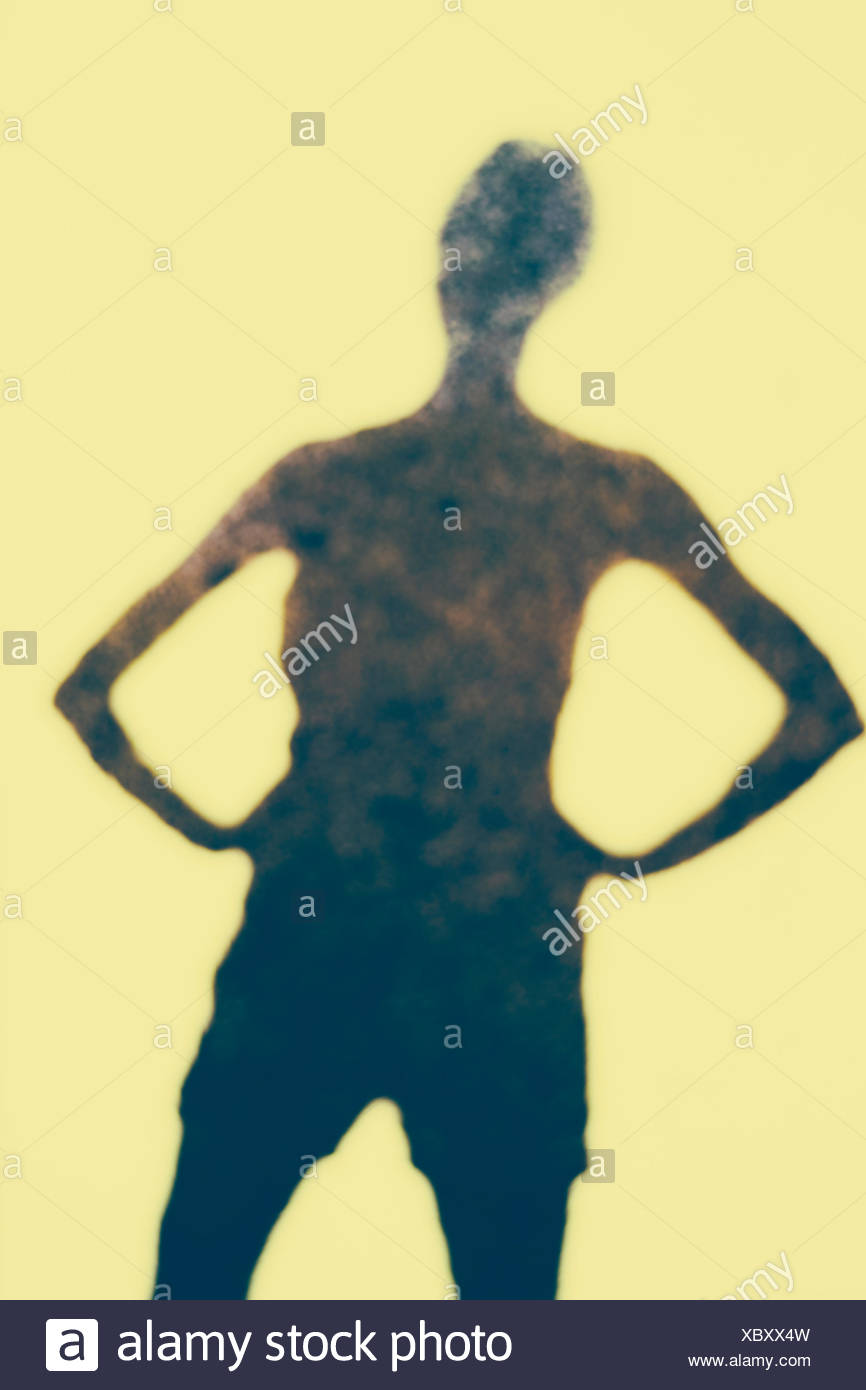 The Outline Of A Human Body A Shadow Against A Plain Background