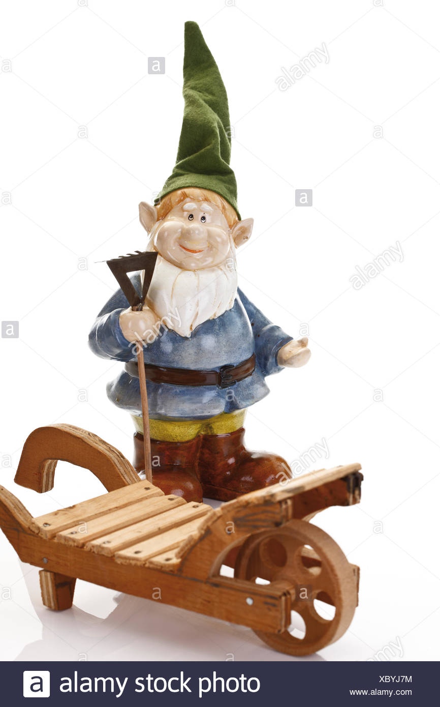 Garden Gnome Wearing Pointed Hat Holding Rake And Standing Next To A Wooden  Cart