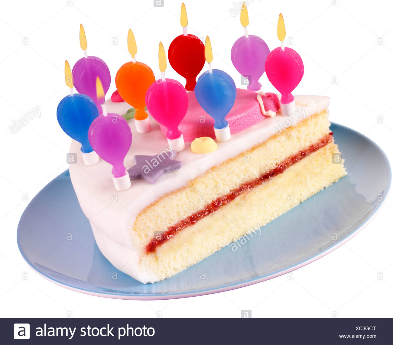 Cut Out Slice Of Birthday Cake With Lit Candles Stock Photo