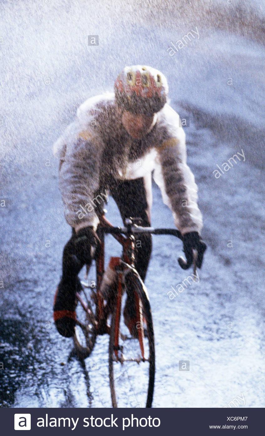 man biking through heavy rain stock photo 282891287 alamy