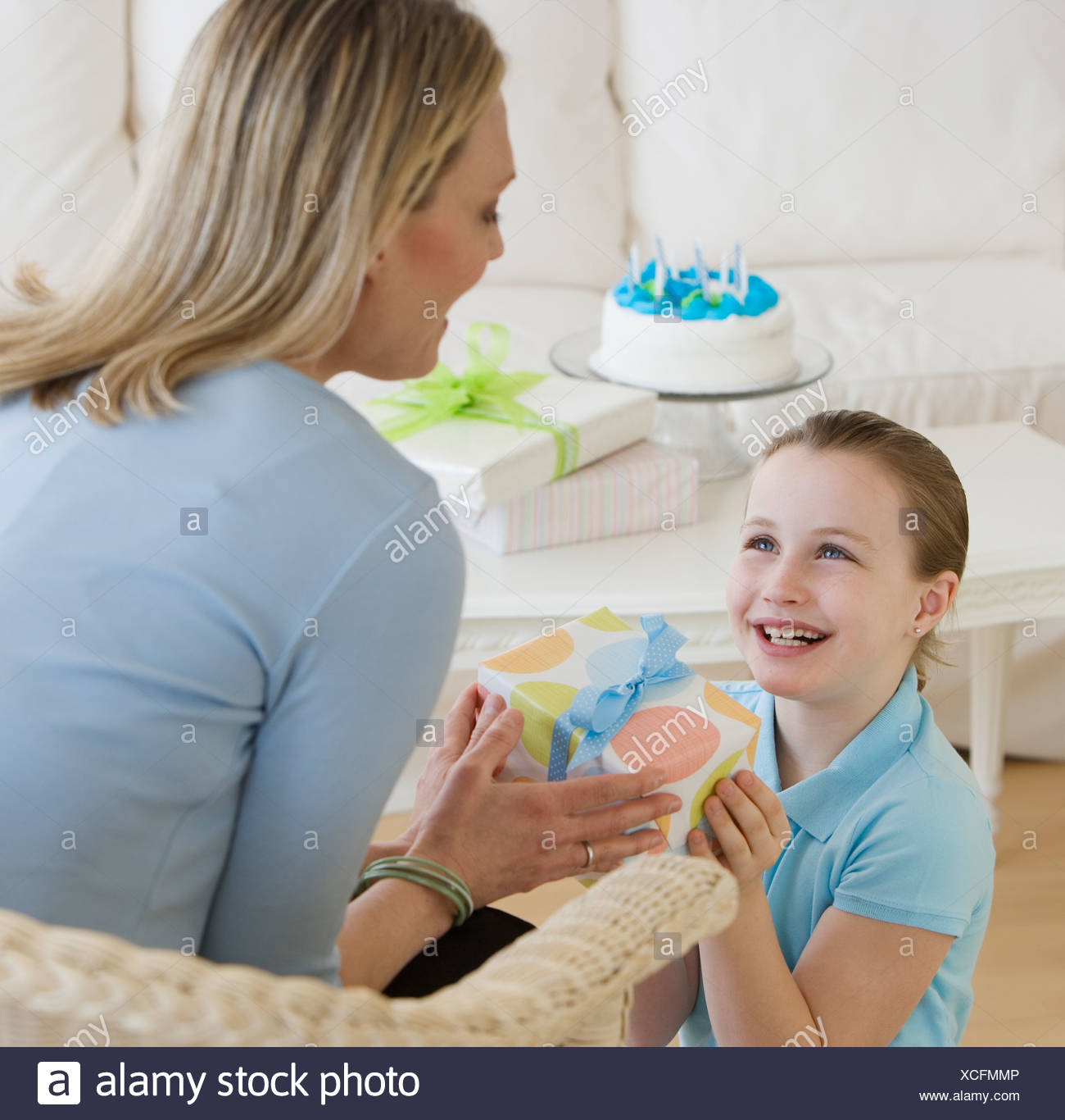 Mother Giving Daughter Birthday Gift