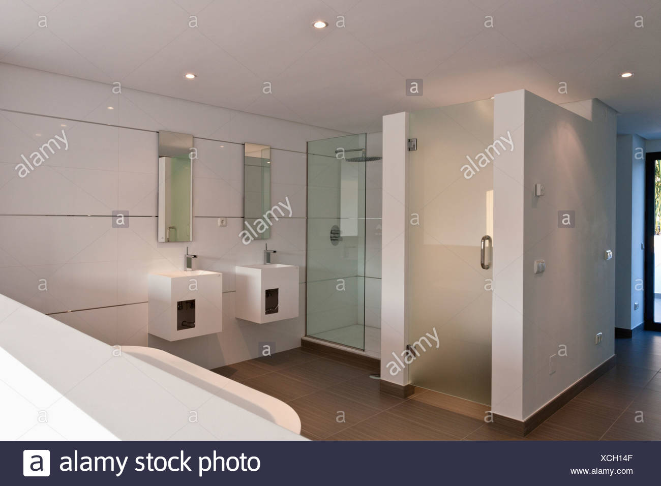 Double showers and basins in square vanity units in modern white ...
