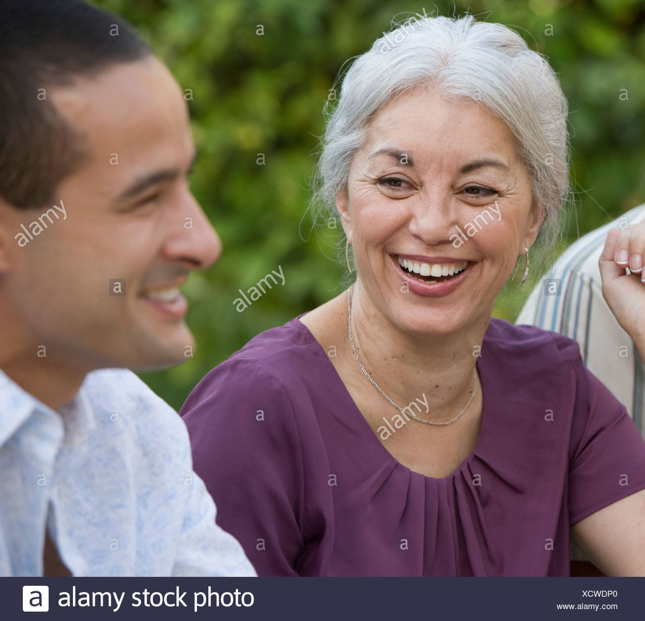 Mother and adult son laughing outdoors