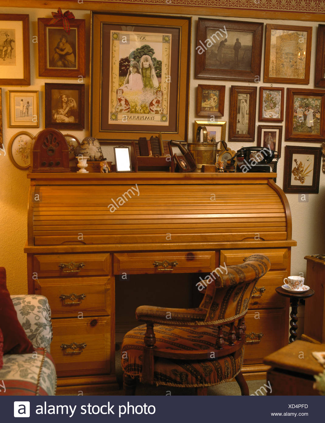 Collection of old framed photographs on wall above antique roll top desk in  country study - Collection Of Old Framed Photographs On Wall Above Antique Roll Top