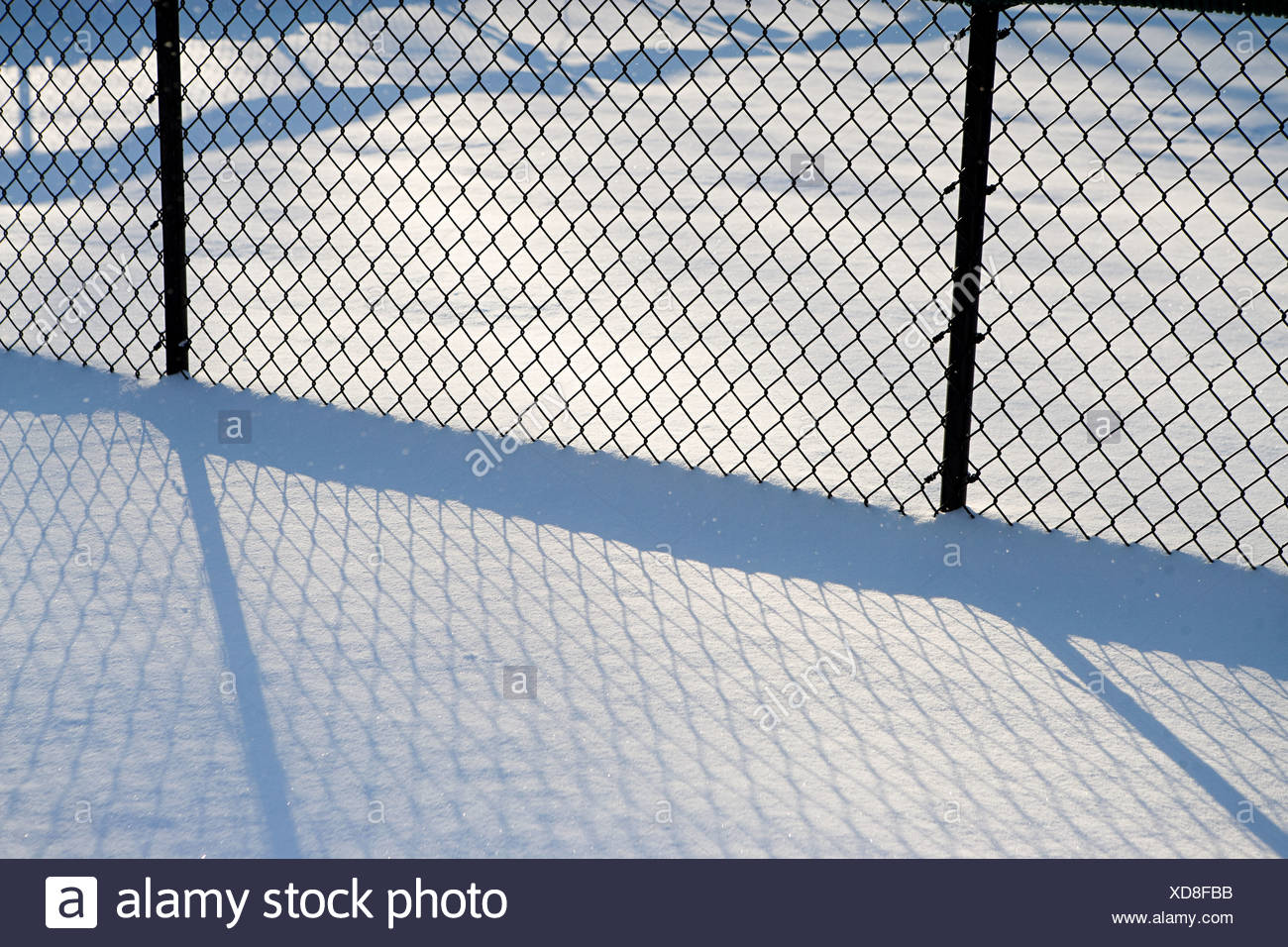 Wire mesh fence in snow, abstract Stock Photo: 283544111 - Alamy