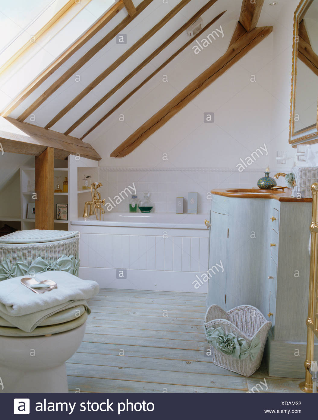 Beamed, sloping ceiling in loft conversion bathroom with curved ...