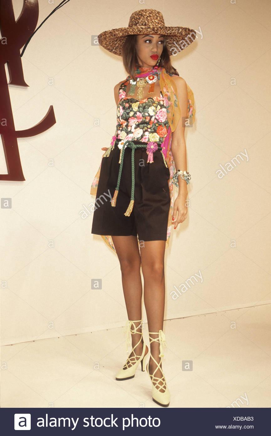 2a9b30f5d6d Yves Saint Laurent Spring Summer Model wearing wide brimmed straw ...