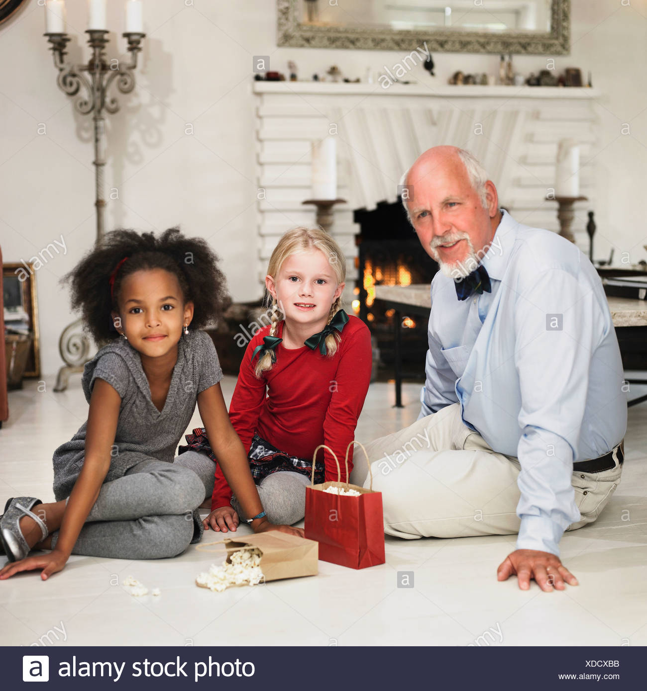 older man and girls with christmas gifts
