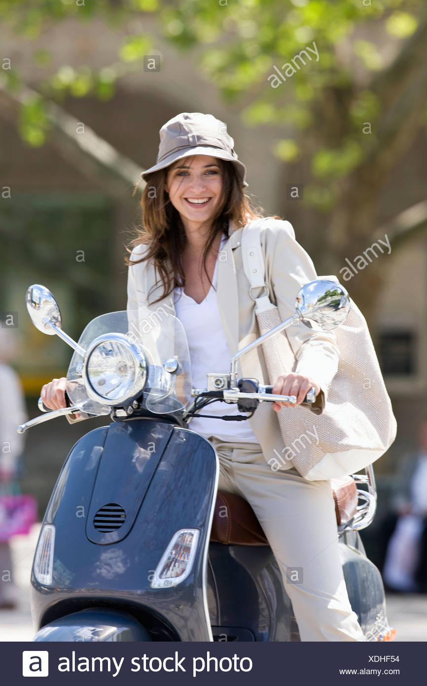 smiling woman riding scooter on stock photos smiling. Black Bedroom Furniture Sets. Home Design Ideas