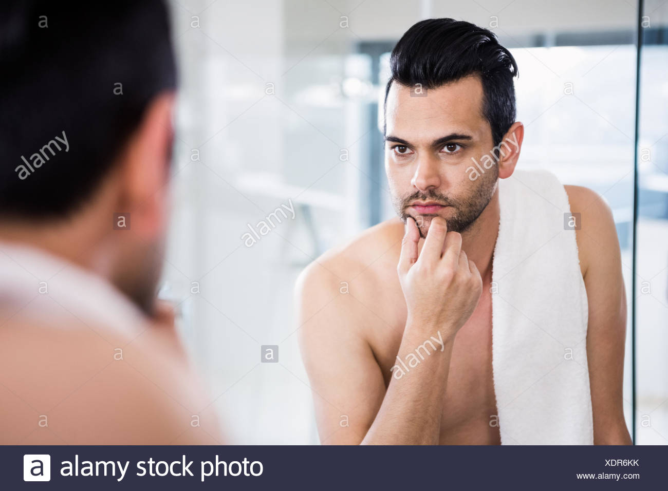 handsome man looking in mirror stock photo 283866567 alamy