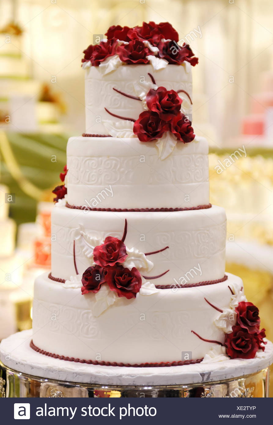 Tiered Wedding Cake Decorated With Red Roses Stock Photo 284034570