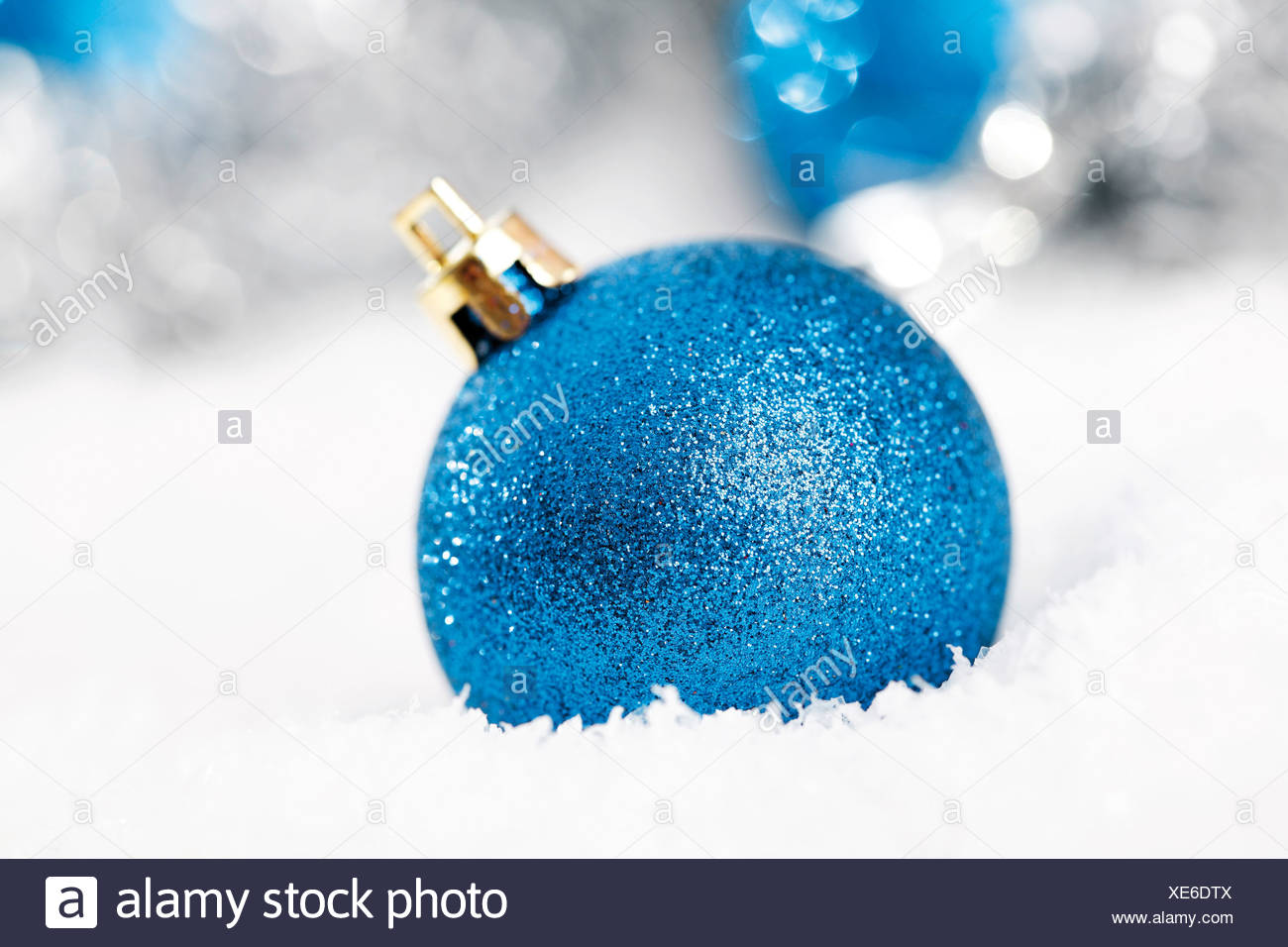 blue glitter christmas tree balls on snow with christmas decorations - Blue Christmas Tree Ornaments