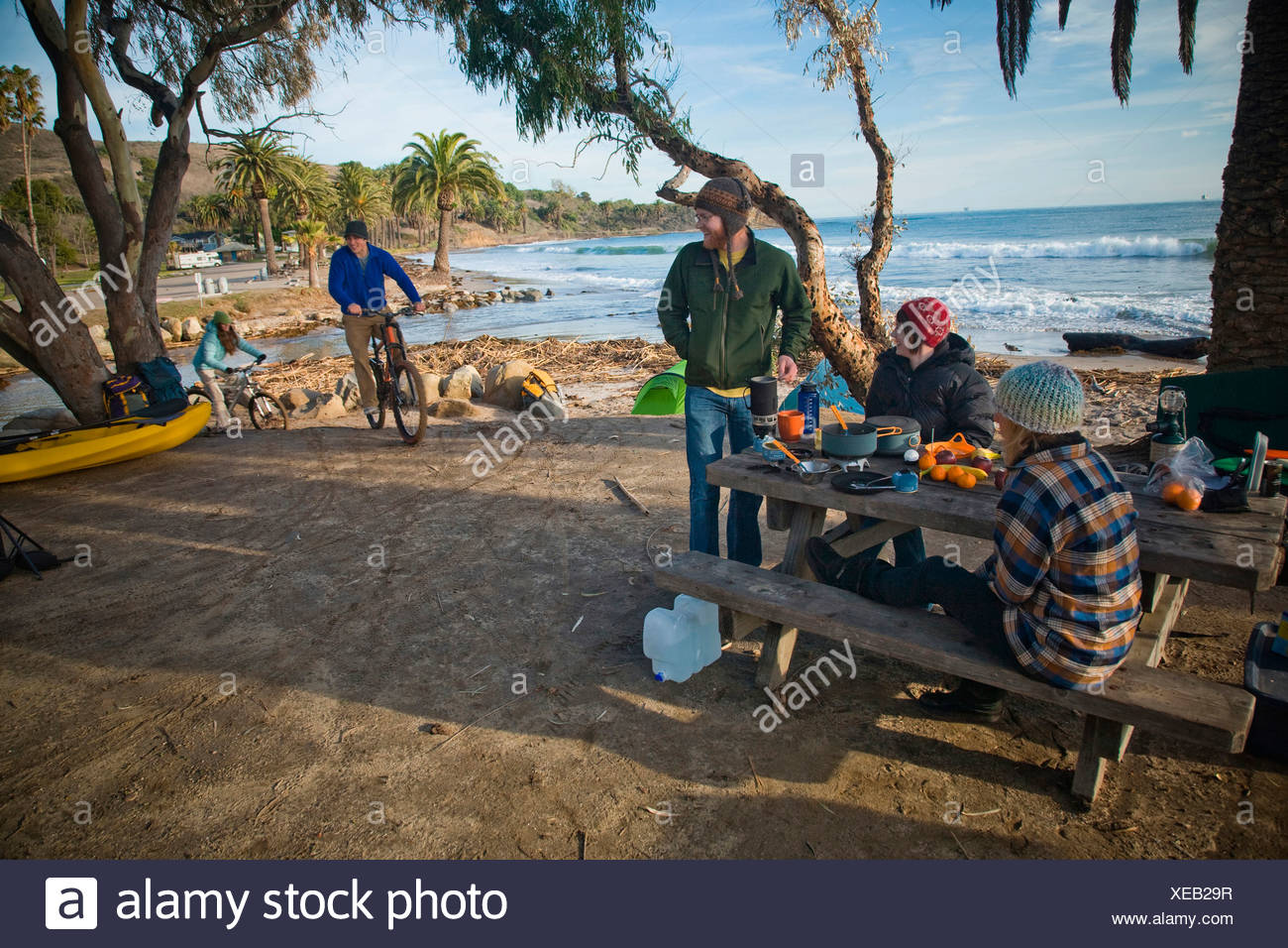 a group of young adults camping at el capitan state beach stock