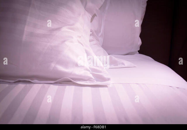 bed down comforter feather pillows stock image