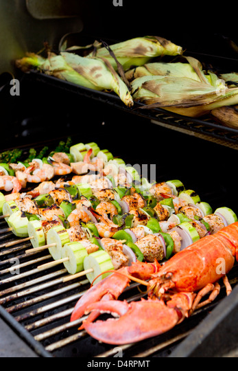 Salmon Skewers, Lobster and cornstalks are on the barbecue. - Stock ...