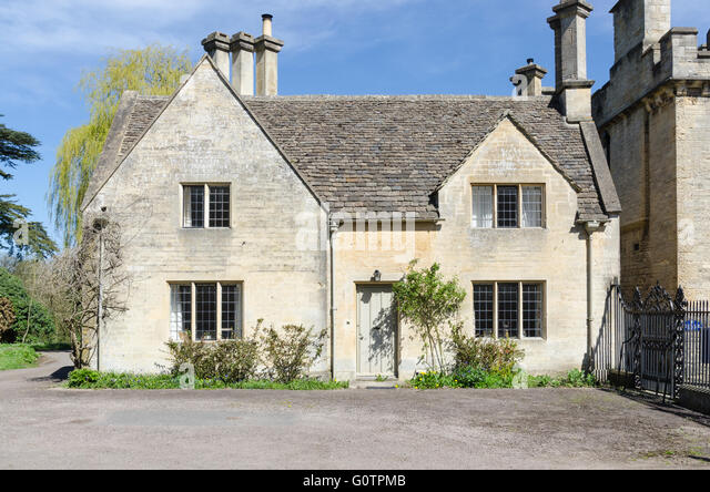 Typical Cotswold Stone House At The Entrance To Cirencester Park On Bathurst Estate In