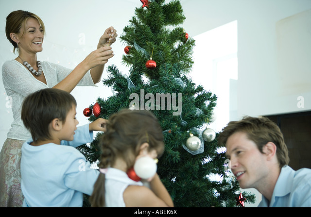 People Decorating For Christmas decorating christmas tree interior stock photos & decorating