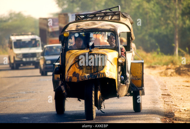 beat up old car travelling along country road from aurangabad to bombay in india stock