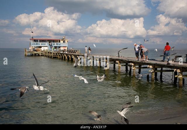 Rod reel pier anna maria stock photos rod reel pier anna for Anna maria island fishing pier
