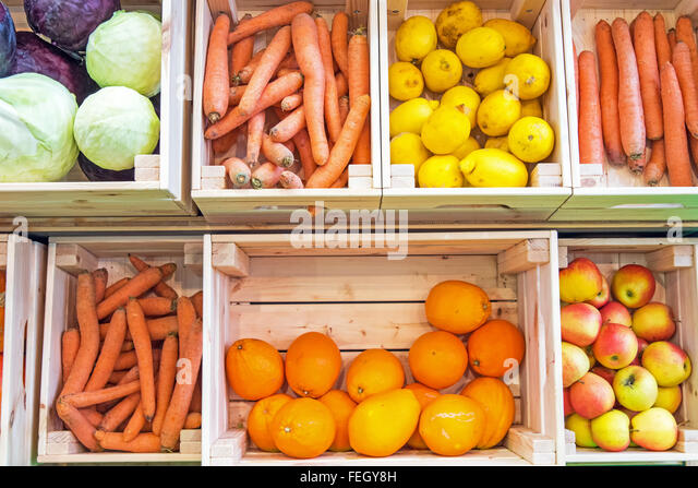 Fruits And Vegetables In Wooden Boxes For Sale At A Market   Stock Image