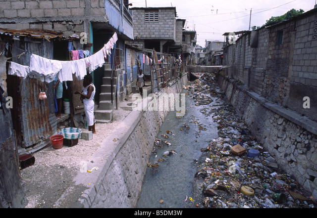 Polluted Canal In Inner City Stock Photos & Polluted Canal
