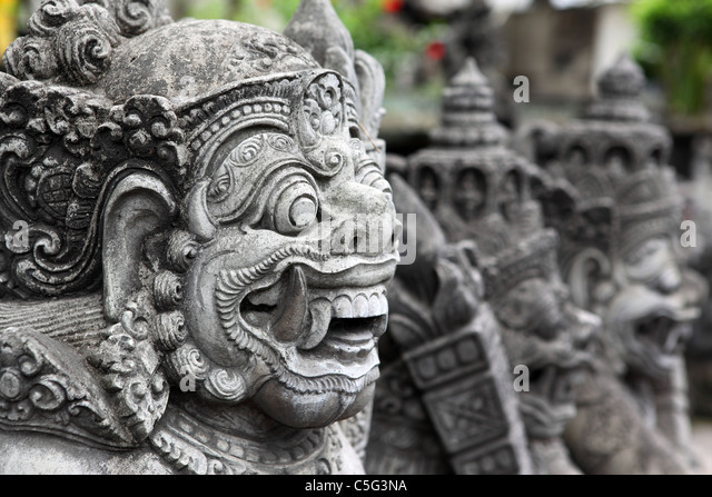 Stone carving mask sculpture stock photos