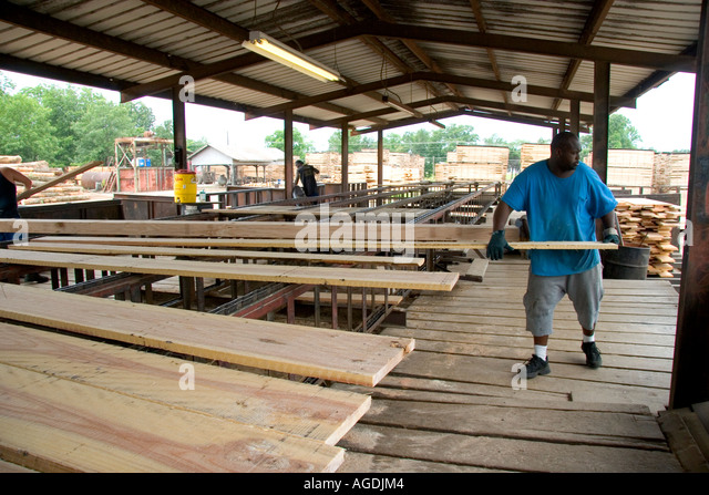 Saw mill workers stock photos