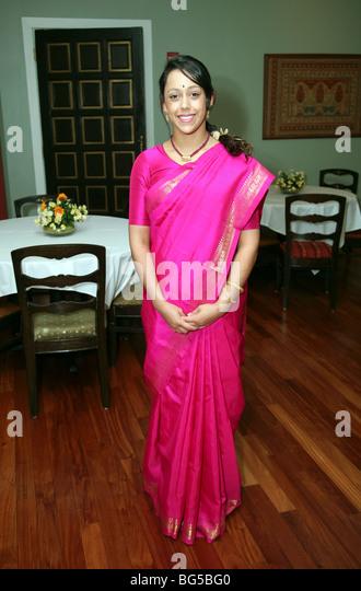 Attractive Indian Teenage Girl Age Aged 18 Years Old, Wearing A Pink Sari    Stock