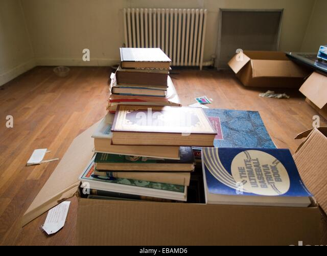 pile of books in cardboard box inside of a foreclosed house in bronx stock photo picture and. Black Bedroom Furniture Sets. Home Design Ideas