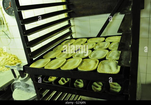 rack-of-pies-ready-for-the-oven-at-cookes-pie-and-mash-shop-goldhawk ...