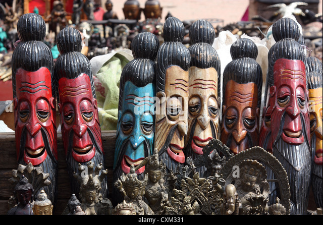 Wood carving faces stock photos