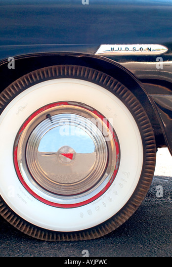 close up of white wall tire on classic hudson automobile stock image