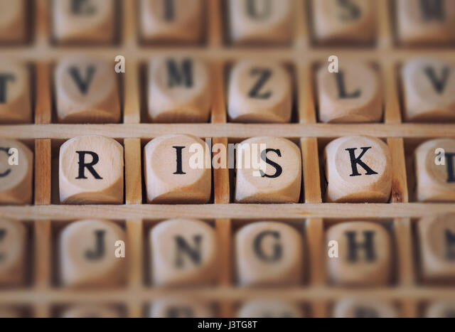 RISK word made with building blocks - Stock Image