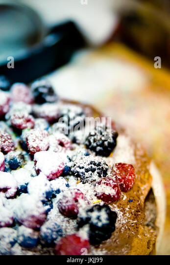 Fresh homemade forest fruits cake with wild fresh blueberries and raspberries. Cake with berries. - Stock Image