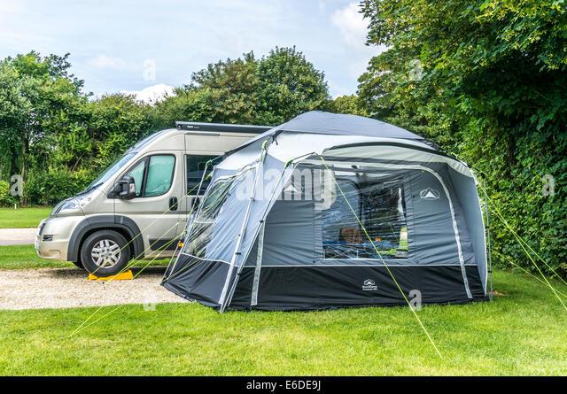 A Van Conversion Motorhome And Tent On Caravan Club Campsite In England UK