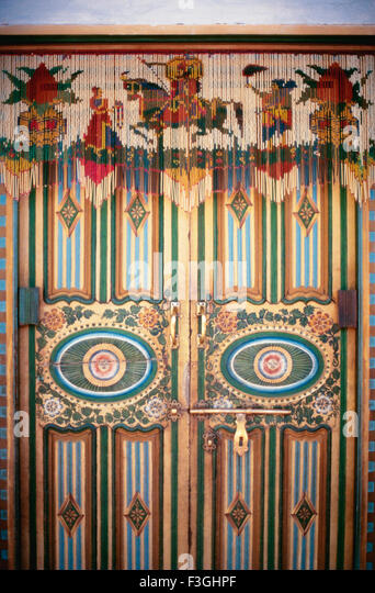 A Painted Wooden Door With A Hanging Made Of Glass Tubes And Beads ; Kathi  Home
