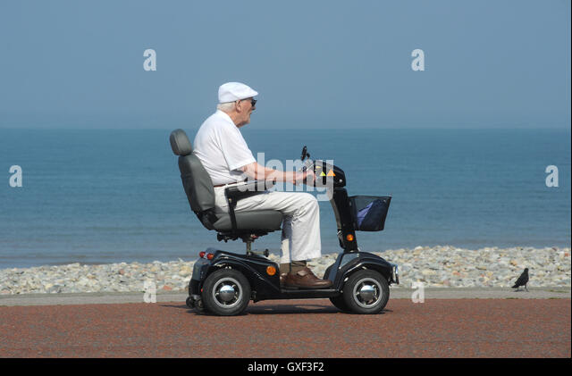 disability scooter stock photos disability scooter stock images alamy. Black Bedroom Furniture Sets. Home Design Ideas