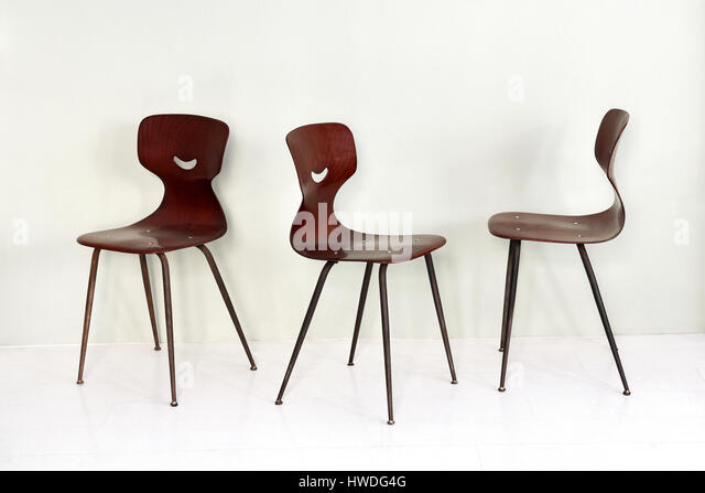 stylish wooden bentwood chairs with curved seats and metal legs displayed at three angles to show