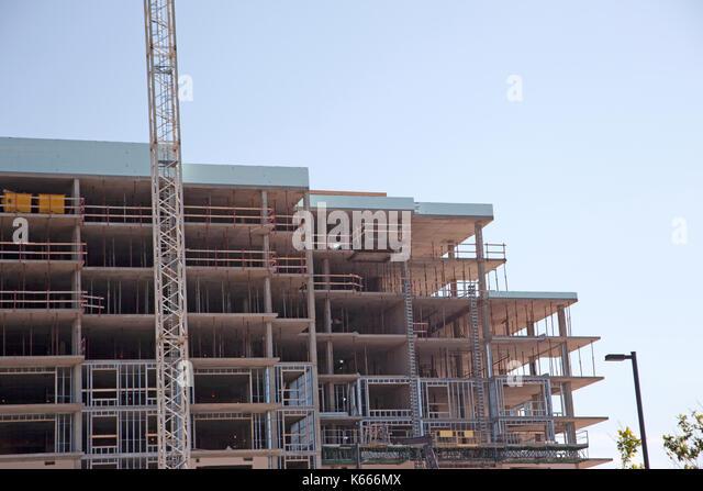 Steel frame building under construction stock photos for Building under construction insurance
