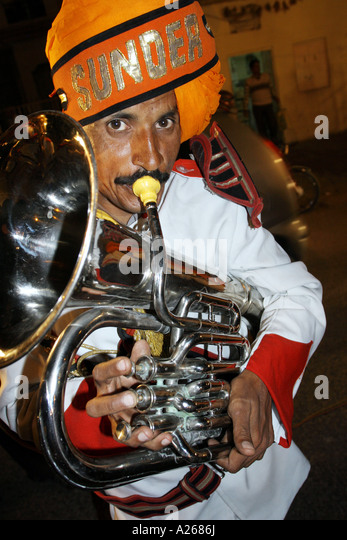 Man In A Traditional Wedding Band Procession Along The Streets Of Pushka India