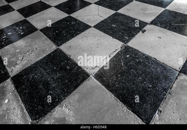 Checkered floor tiles stock photos checkered floor tiles for Black and white check floor