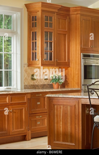 Wooden cabinets stock photos wooden cabinets stock for Kitchen cabinet section