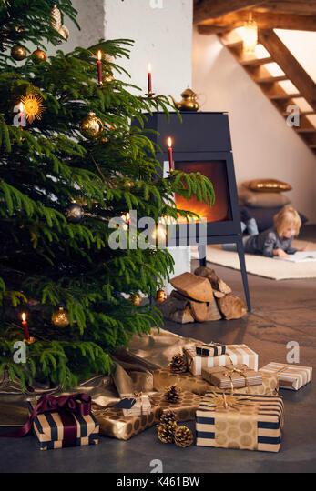 Christmas tree presents fireplace stock photos