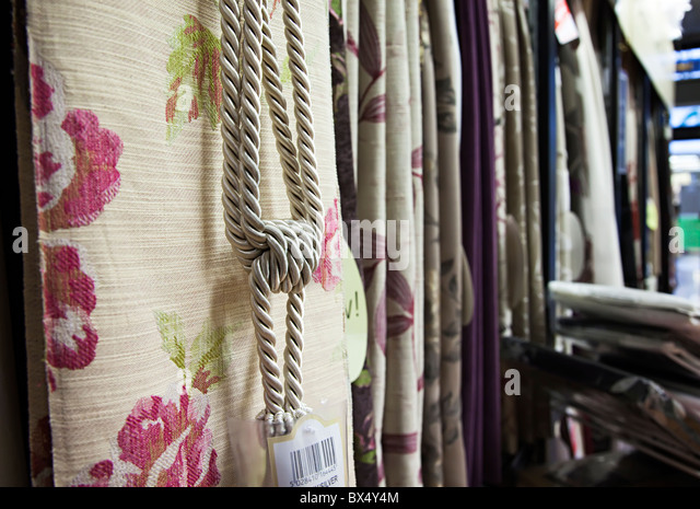 tie backs and curtain fabrics on sale in shop england uk stock image