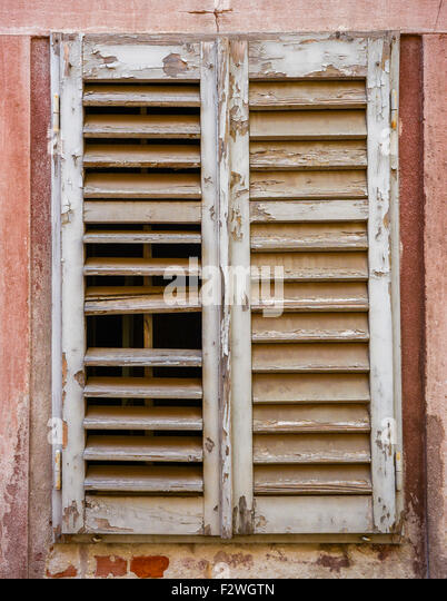 Wood Shutters Closed : Shutter wood paint close up stock photos