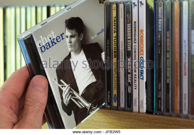 In a Soulful Mood, Chet Baker CD being chosen from a shelf of other CD's, Dorset, England - Stock Image