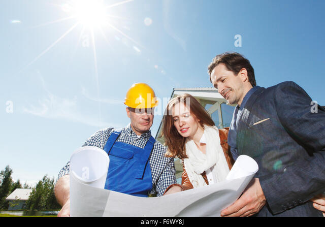 Architect young family construction site stock photos architect young family construction site - House plans for young couples energetic designs ...