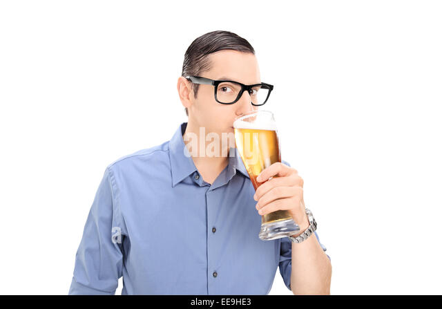 Young guy drinking a pint of beer isolated on white background stock