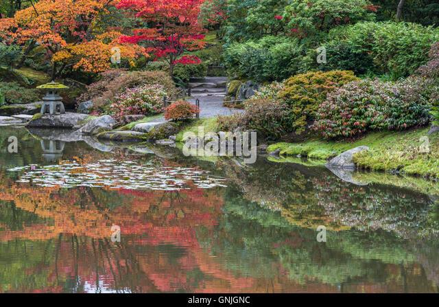 Beautiful stone lantern japanese garden stock photos for Japanese garden colors
