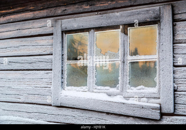 Frosty Window Of Old Barn With Sky And Trees Reflecting In It Gllivare Swedish